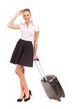 带着台车手提箱的空中小姐。 免版税库存图片