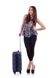 带着在旅行概念被隔绝的手提箱的妇女 免版税库存照片