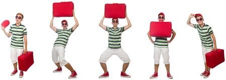 带着在白色隔绝的红色手提箱的年轻人 免版税库存图片