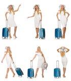 带着在白色隔绝的手提箱的旅行的妇女 免版税库存照片