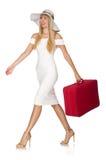带着在白色隔绝的红色手提箱的妇女 库存照片