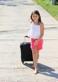 带着手提箱的女孩 图库摄影