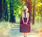 带着手提箱的女孩 库存照片