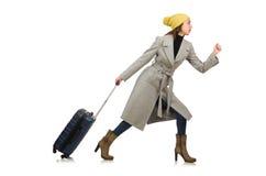带着手提箱的妇女准备好在冬天假期 免版税库存图片
