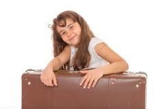 带着手提箱的小女孩 库存图片