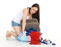 带着手提箱的少妇 免版税库存图片