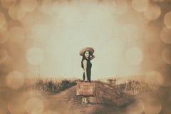 带着手提箱的深色的女孩 库存照片