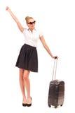 带着手提箱的激动的女实业家。 免版税库存照片