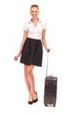 带着手提箱的美丽的少妇。 图库摄影