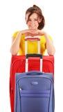 带着旅行手提箱的少妇。旅游为旅行准备 免版税图库摄影