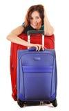 带着旅行手提箱的少妇。旅游为旅行准备 免版税库存照片