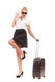 带着黑手提箱的女实业家做好标志。 库存照片