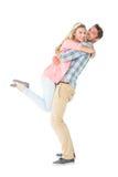 带走和拥抱他的女朋友的英俊的人 免版税库存图片