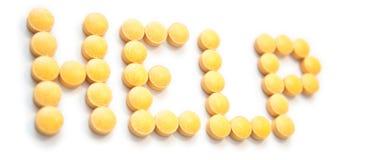 帮助做桔子药片符号 免版税图库摄影