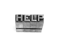 帮助标志,古色古香的金属信件类型 免版税图库摄影