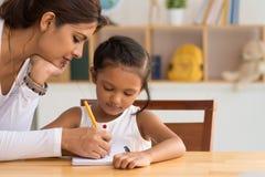 帮助的家庭作业 免版税库存图片