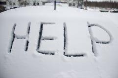 帮助雪汽车冬天 库存图片