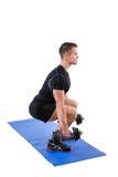 常设哑铃小牛培养或蹲坐锻炼 图库摄影