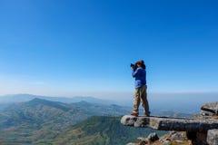 常设岩石的摄影师 免版税库存图片