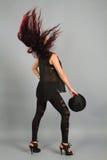 戴黑帽会议的性感的女孩 图库摄影