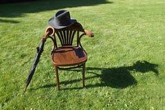 帽子、伞和椅子 库存图片
