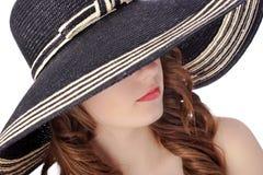 帽子佩带的妇女 免版税图库摄影