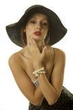 帽子俏丽的妇女 免版税库存照片
