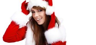 帽子圣诞老人佩带的妇女 免版税库存照片