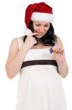 帽子怀孕的圣诞老人妇女 图库摄影