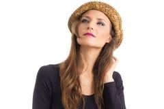 帽子的妇女查寻 有嫉妒和金发的人 免版税库存图片