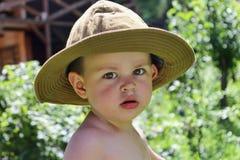 帽子的男孩 免版税库存照片