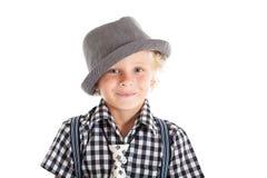 戴帽子的白肤金发的男孩画象 库存图片