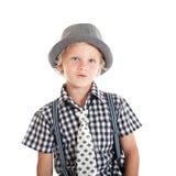 戴帽子的白肤金发的男孩画象 免版税库存照片
