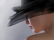 帽子的美丽的女孩 免版税库存图片