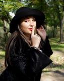 帽子的美丽的女孩 库存照片