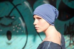 帽子的美丽的女孩 免版税图库摄影