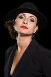 帽子的轰烈的妇女 免版税库存图片