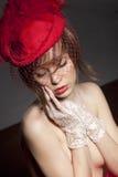 帽子红色性感的妇女 图库摄影