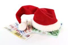 帽子货币圣诞老人 库存图片