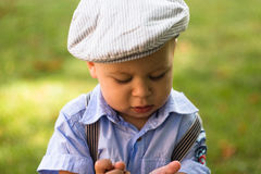 帽子面孔表示的男婴 库存图片