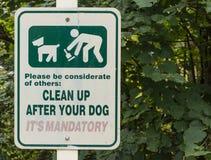 干净在您以后狗标志 免版税库存照片
