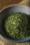 干燥有机绿色荷兰芹剥落 库存图片