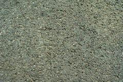 干燥高速公路柏油碎石地面覆盖物纹理 库存照片