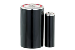 黑干电池D和AA估量在黑色的电池 免版税库存照片