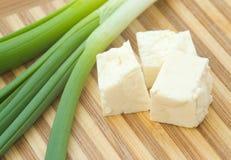干酪求葱的立方 免版税库存图片
