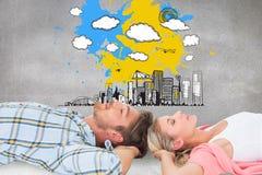 平安地睡觉有吸引力的年轻的夫妇的综合图象 库存照片