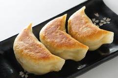 平底锅油煎的饺子 免版税库存照片