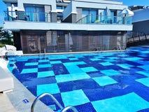 平房的游泳 库存图片
