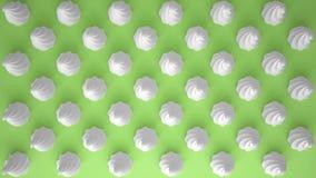 平的五颜六色的流行艺术构成用白色党杯形蛋糕,面包店好吃的东西,在绿色背景,仿造纹理拷贝 免版税库存图片