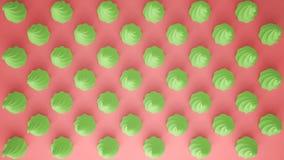 平的五颜六色的流行艺术构成用绿党杯形蛋糕,面包店好吃的东西,在桃红色背景,仿造纹理拷贝 图库摄影